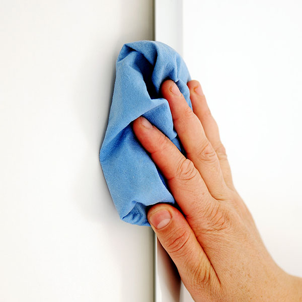 Female hand cleaning surface